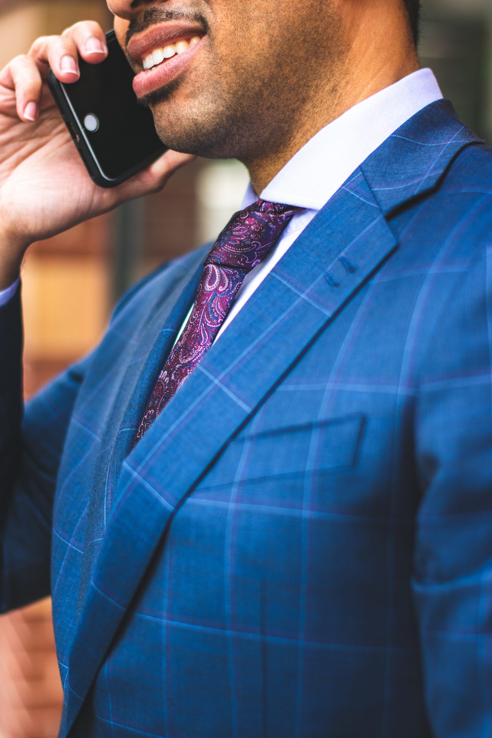 close-up-photo-of-man-in-blue-pinstripe-suit-jacket-talking-2254120